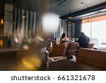 couple eating at a restaurant... | Shutterstock . vector #661321678