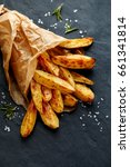 baked potato wedges  with... | Shutterstock . vector #661341814