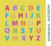 alphabet on yellow background | Shutterstock . vector #661350394