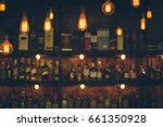 Small photo of Soft focus picture of vintage lamps with blurred liquor bar in Vintage photo filter style.