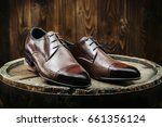 Stylish Men's Shoes On A Woode...