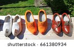 Dutch Wooden Shoes On A Wood...