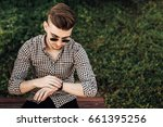 fashionable man look at watch ... | Shutterstock . vector #661395256