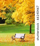 bench and maple in city park in ... | Shutterstock . vector #66140467