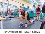 man stretching and women doing... | Shutterstock . vector #661452529
