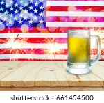 glass of beer on wooden table.... | Shutterstock . vector #661454500