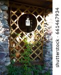 Small photo of wooden alcove in the garden with lanterns