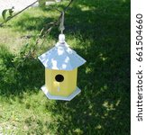 A Small Yellow Birdhouse...