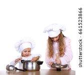 two cute little girls playing... | Shutterstock . vector #661523866