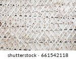 wall with planks nailed.... | Shutterstock . vector #661542118