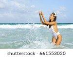 happy woman wearing white... | Shutterstock . vector #661553020