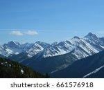 snowy rocky mountain peaks | Shutterstock . vector #661576918