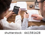 close up of couple calculating... | Shutterstock . vector #661581628