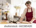 happy senior woman rolling... | Shutterstock . vector #661585420