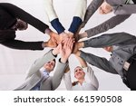 group of businesspeople putting ... | Shutterstock . vector #661590508