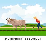Farmer Plowing Paddy Field Wit...