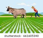 farmer plowing paddy field with ... | Shutterstock .eps vector #661605340
