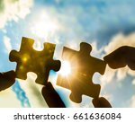 two hands trying to connect... | Shutterstock . vector #661636084