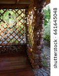 Small photo of wooden alcove in the garden with.a lantern hanging