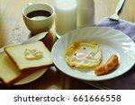 fried egg and pork sausage... | Shutterstock . vector #661666558