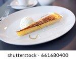 thin wedge of lemon tart served ... | Shutterstock . vector #661680400