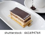 slice of cake with layers of... | Shutterstock . vector #661694764