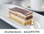 slice of cake with layers of... | Shutterstock . vector #661694794