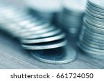 row of coins on wood background ... | Shutterstock . vector #661724050