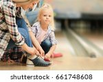 family changing shoes in... | Shutterstock . vector #661748608