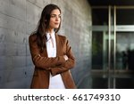 young businesswoman standing... | Shutterstock . vector #661749310