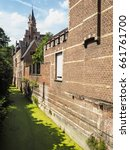 Small photo of The ' Groen Waterke' or green brook, a small canal covered in duckweed, next to the houses of refuge of the St Trond's abbey and Tongerlo Abbey in the city center of Mechelen, Belgium