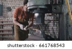 man blacksmith in workshop... | Shutterstock . vector #661768543