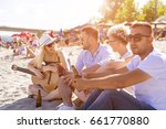 group of friends playing guitar ... | Shutterstock . vector #661770880