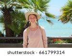 pretty girl tourist on the beach   Shutterstock . vector #661799314