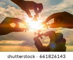 collaborate four hands trying... | Shutterstock . vector #661826143