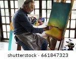 Artist Painting Artwork At...