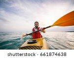 sea kayaking. man paddling... | Shutterstock . vector #661874638