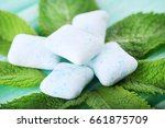 chewing gums with mint leafs on ... | Shutterstock . vector #661875709