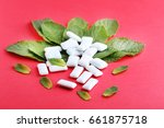 chewing gums with mint leafs on ... | Shutterstock . vector #661875718