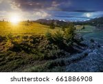 carpathian mountain ridge with snowy peaks. Grassy alpine meadow with spruce forest in spring season. Fine weather with blue sky and some clouds on sunny day - stock photo