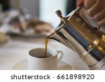 pouring a cup of coffee. pour | Shutterstock . vector #661898920