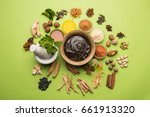 Small photo of Ayurvedic Chyawanprash is a Powerful Immunity Booster OR Natural Health Supplement. Served in an Antique bowl with Ingredients, over moody background, selective focus