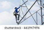 lineman climbing on... | Shutterstock . vector #661947496
