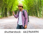 young asian traveler man... | Shutterstock . vector #661964494