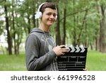 teenage young boy in earphones... | Shutterstock . vector #661996528