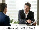 Small photo of Financial adviser consulting businessman, holding paper, explaining contract terms or investment plan, bank worker helping client with document, salesman proposing good deal to customer, making offer