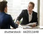 Small photo of Smiling manager and client handshaking, satisfied businessmen shaking hands offering financial contract, support, help, good business deal, reaching agreement, business analytics, graphs stats on desk