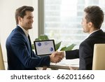 two smiling businessmen... | Shutterstock . vector #662011660