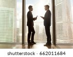 two businessmen talking... | Shutterstock . vector #662011684