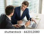two serious businessmen using... | Shutterstock . vector #662012080